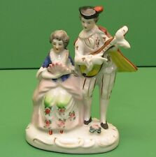 Occupied Japan figurine couple scene. woman seated man playing instrument