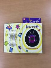 New Bandai Original TamaGotchi Purple, 1996 - 1997 English
