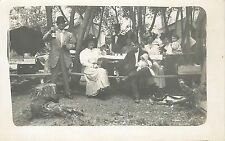 RPPC Postcard People in Fancy Dress Crazy Hat at Picnic man holds a bottle Beer?