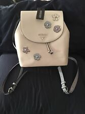 LAST ONE! Authentic Guess White Flower Embossed Backpack/purse
