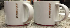 SET OF 2 STARBUCKS 2012 16 OZ WHITE CUP MUG GOLD LETTERS AND RED TRIM STACKABLE