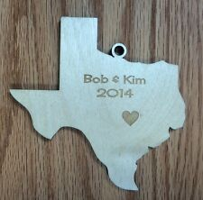 Texas Shaped Christmas Ornament with laser-etched year & names & heart over city