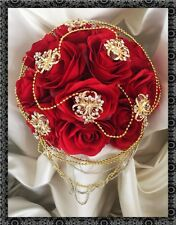 Brides Wedding Posy Red Roses Gold brooches and pearls Indian Asian Wedding