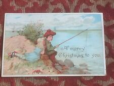 1890s colourful christmas card - boy fishing with his girlfriend