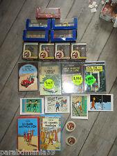 Vente Hergé-Lot conséquent,voitures,cartes,dvd,vhs,badges,figurines