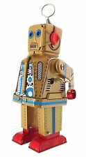 Collectors Gold tin clockwork walking robot with sparking eyes and mouth