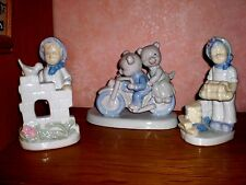 Couple d'enfants en biscuit de porcelaine
