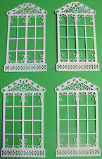 4 Tattered Lace 'window' die-cuts on different coloured 300gsm card