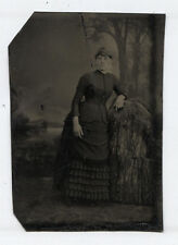 TINTYPE WOMAN WITH CRAZY EYES LEANING ON SCARY PROP.