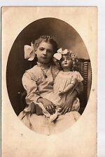 Antique photo RPPC real photo postcard Girl with Huge German Bisque head doll