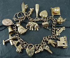 VINTAGE 1960s / 70s  9ct GOLD CHARM BRACELET with 18 charms - 31.5g
