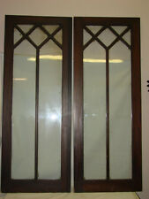PAIR OF ORNATE ANTIQUE OAK GLASS CABINET DOORS 56 X 22