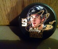 Autographed Bobby Ryan Hockey photo Puck of the Ducks all Autographes 100%