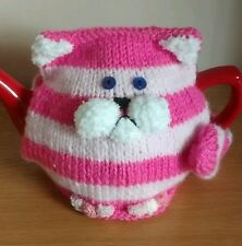 Hand-knitted bagpuss tea cosy. fits up to 2pint/1litre teapot