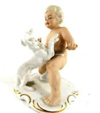 SCHAUBACH KUNST GERMAN PORCELAIN FIGURE OF CHILD WITH DOG