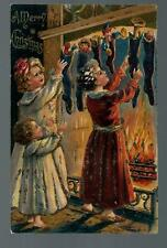 Vintage Christmas Postcard - with young children getting their Xmas stockings VG