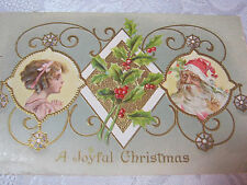 A JOYFUL CHRISTMAS ANTIQUE EMBOSSED WITH SANTA HOLLY & LITTLE GIRL POSTCARD   T*