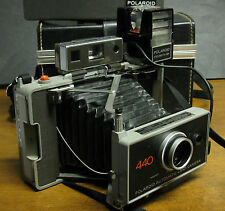 POLAROID 440 AUTOMATIC INSTANT LAND CAMERA  WITH FLASH AND CASE.