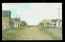 1910 Postcard Dirt Main Street Swanville MN Storefronts Buggies B716