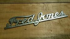 Fred Jones-- Metal  Dealer Emblem Car  vintage