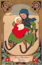 CHRISTMAS HOLIDAY CHILD BABY SLED EMBOSSED PFB POSTCARD (c. 1910)