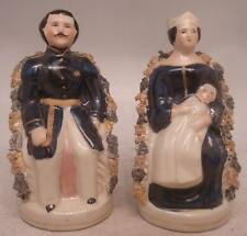 Pair of Staffordshire Pottery Figures - Prince Albert & Queen Victoria with Baby