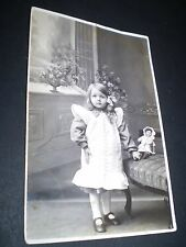 social history beautiful little girl with china doll studio rp photo postcard