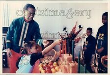 African American Girl Lights Candles For Kwanzaa Celebration Press Photo