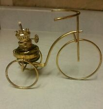 Vintage metal wire made bike with oil lamp