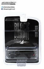 Greenlight Black Bandit: 2014 Ram 1500 with Camper Shell 1:64 Scale (Black)