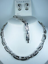 Nina Ricci Rhodium Plated Necklace, Bracelet and Earring with Swarovski Crystals