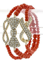 SIDEWAYS BOW STACKED BRACELET TRIO SET ORANGE CANDY FOR THE ARM LOVE AND HIP HOP