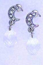 Silver crescent moon earrings with a teardrop style bead dangling down. Stud.