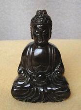 Belle sculpture sur pierre noire de la statue de Bouddha