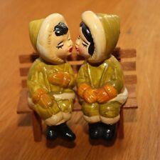 Vintage Eskimo Children Boy & Girl Kissing Salt & Pepper Shakers on Wooden Bench