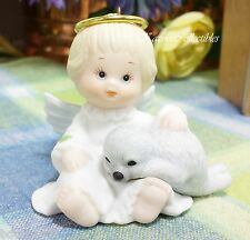 Enesco Holly Babes Ruth Morehead Baby Angel ornament with baby seal