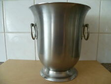 A  POLISHED METAL, WITH HOOP HANDLES, CHAMPAGNE BUCKET, BY GUY DEGRENNE, FRANCE