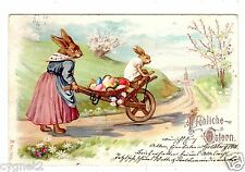 POSTCARD GERMAN EASTER RABBITS CARRY EGGS ON WOODEN CART1901