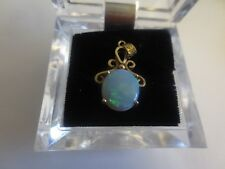 Genuine 14K Gold very fancy setting and high quality opal pendant