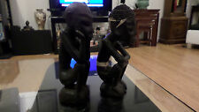 A PAIR OF VINTAGE HAND CARVED WOOD AFRICAN FIGURINES