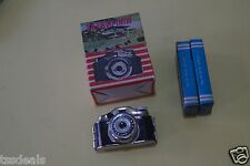 Mini camera w 2 pkgs of old useless film