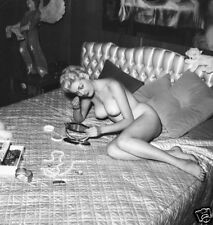 1960s Nude Pinup lying on a bed putting on makeup 5 x 5 Photograph