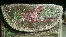 Accessorize beaded clutch with  sequined butterfly and embroidered trim