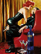 Skyy Vodka 1-pg clipping ad 2000 red chair, red hair, black dress, woman on lap
