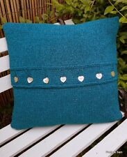 Large dark blue/green hand knitted cushion with shell buttons