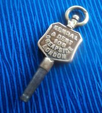Advertising Pocket Watch Key - Kendal & Dent of 106 Cheapside  London