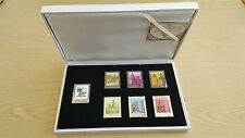Box of seven Shanghai 2010 medallions shaped like stamps in white metal
