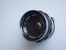 vintage non AI 35mm f2.8 Nikkor lens w/ nice bw uv filter on it