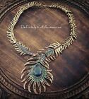 Stunning gold & rainbow coloured crystal peacock feather statement necklace