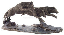 "Three Wolves on the Run Jumping Over a Stream (Bronze) 6.5"" H X 14"" L Statue"